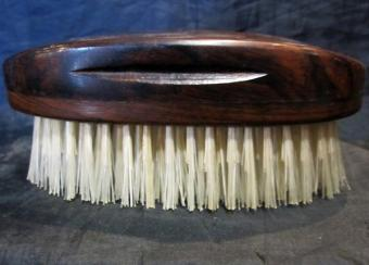 Hand-drawn rosewood military oval