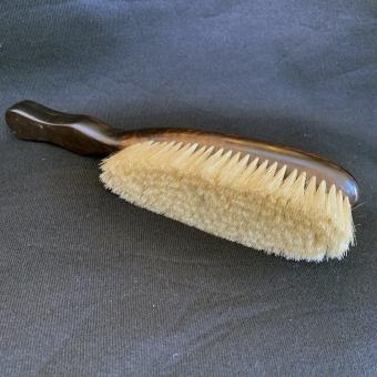 Ebony enormity clothes brush